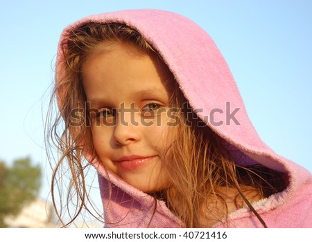 Close-up portrait of little girl in a bathrobe - stock photo