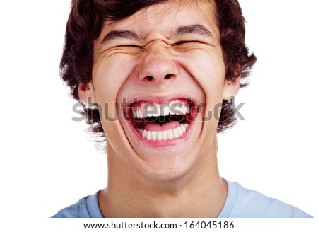 Close up portrait of loudly laughing young man isolated on white background - stock photo