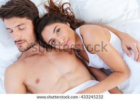 Close-up portrait of lovers sleeping together in bed at home - stock photo