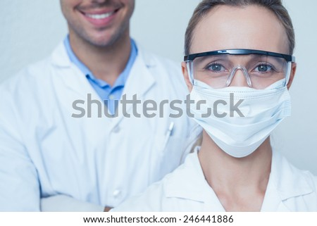 Close up portrait of male and female dentists