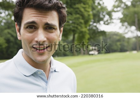 Close up portrait of man on golf course