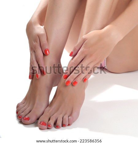 Close-up portrait of manicured nails and pedicured toes with gel