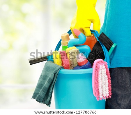 close up portrait of mans hand with cleaning equipment - stock photo