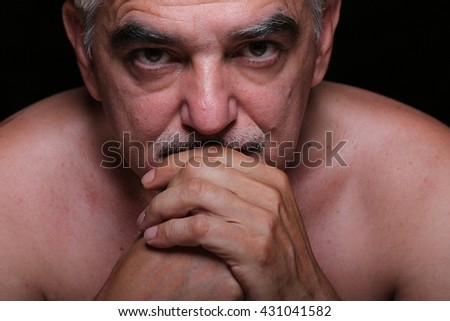 Close up portrait of mature man,thoughtful and sad.Non retouched photography