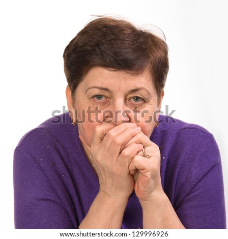 Close-up portrait of mature woman with hands on a mouth on a white background - stock photo
