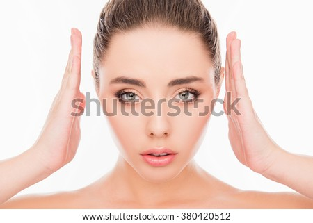 Close up portrait of minded woman holding hands near face and making frame - stock photo