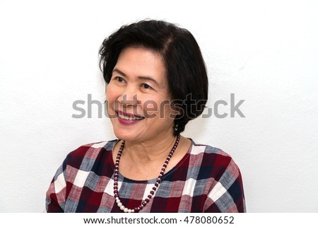 Close-up portrait of old woman smiling