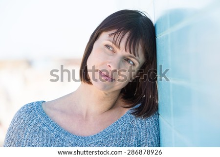 Close up portrait of one attractive middle aged woman  - stock photo