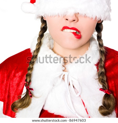 close up portrait of one woman dressed as santa claus christmas hat blinfold puckering on studio isolated white background