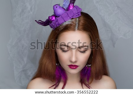 Close-up portrait of perfect woman face. Bright make up - red lips, shadows long lashes. Creative hair dress with purple birds sitting on head, pigeon mail. New crazy art fashion beauty magazine idea - stock photo