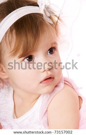 Close-up portrait of pretty baby girl, studio shot - stock photo