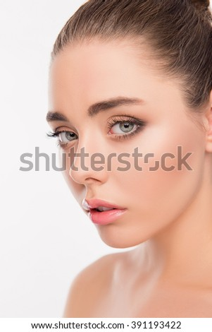 Close up portrait of pretty woman with eyes like gimlets - stock photo