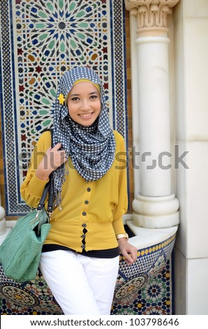 Close-up portrait of pretty young Asian pose and smile - stock photo