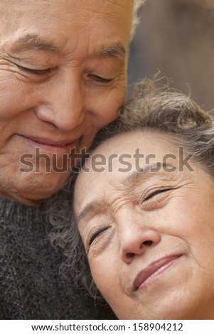 Close-up portrait of senior couple - stock photo