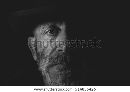 Close up portrait of senior man in black and white