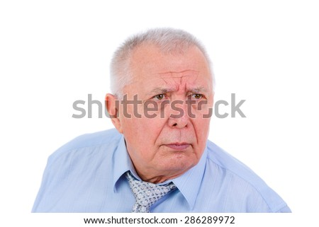 Close-up portrait of serious and strict senior old businessman, dressed in blue shirt and tie, isolated on white background. Human emotions and facial expressions - stock photo