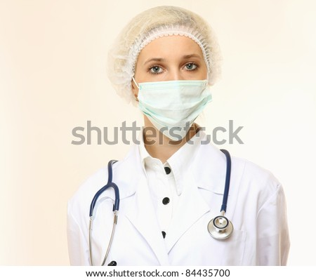 Close-up portrait of serious nurse or doctor in mask isolated