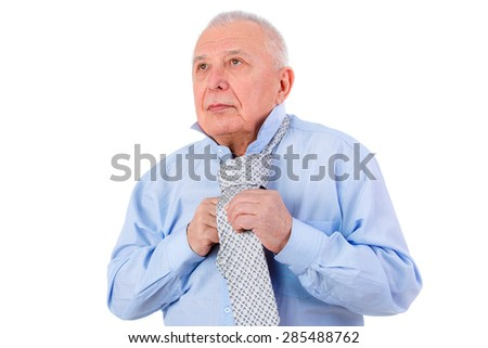 Close-up portrait of Serious old mature businessman ties a tie. isolated on white background.  - stock photo