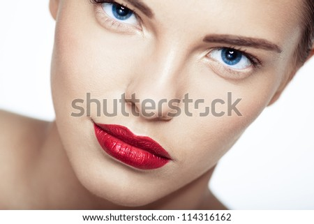 Close-up portrait of sexy caucasian young model with glamour red lips make-up. Perfect clean skin. - stock photo