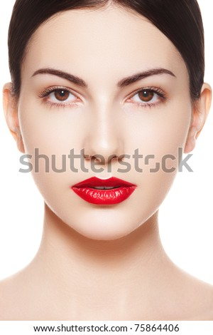 Close-up portrait of sexy caucasian young model with glamour red lips make-up. Perfect clean skin. Spanish woman purity face with bright lips makeup - stock photo