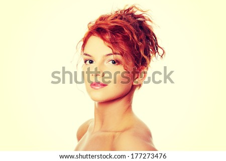 Close-up portrait of sexy caucasian young redhead woman, isolated on white
