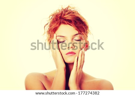 Close-up portrait of sexy caucasian young redhead woman, isolated on white - stock photo