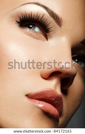 Close-up portrait of sexy caucasian young woman with long eyelashes - stock photo