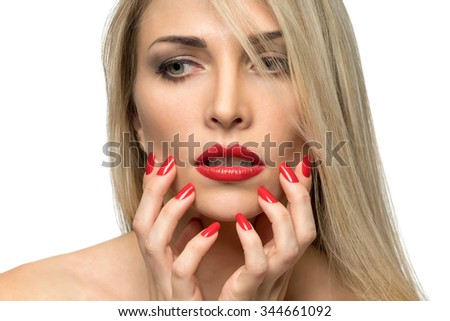 Close-up portrait of sexy woman lips with red lipstick and red manicure