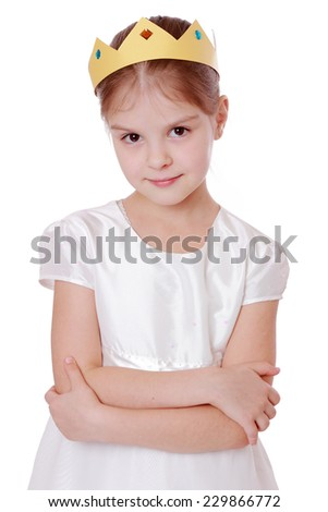 Close up portrait of smiley little girl wearing paper crown - stock photo