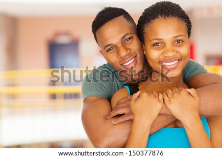 close up portrait of smiling afro american college couple - stock photo