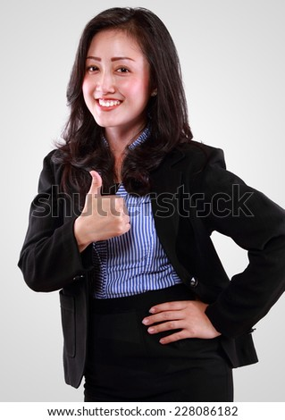Close Up Portrait of smiling business woman in success - stock photo