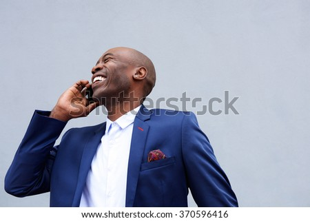 Close up portrait of smiling businessman talking on mobile phone  - stock photo