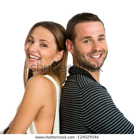 Close up portrait of smiling couple back to back.Isolated on white. - stock photo