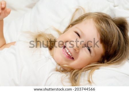 Close-up portrait of smiling little girl - stock photo