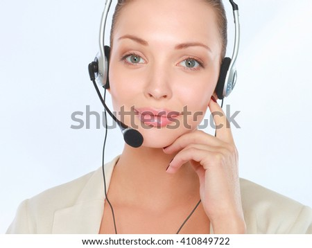 Close-up portrait of smiling young woman with headset isolated on white background - stock photo