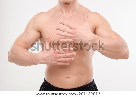 Close up portrait of strong masculine torso with hands - stock photo