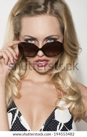 close-up portrait of summer beauty girl with blonde girl , bikini and sunglasses. Charming expression  - stock photo