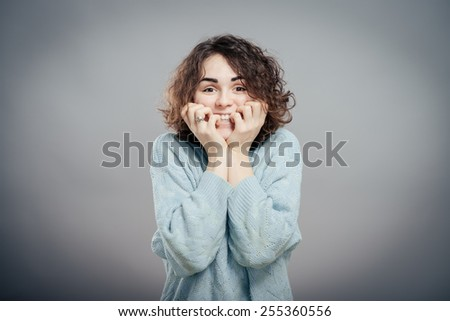 Close-up portrait of surprised beautiful girl holding her head in amazement and open-mouthed.  - stock photo