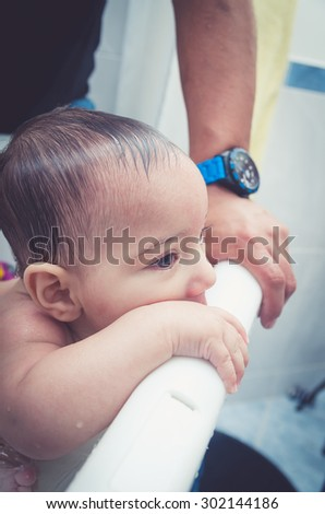 Close up portrait of sweet baby boy in the bathtub - stock photo