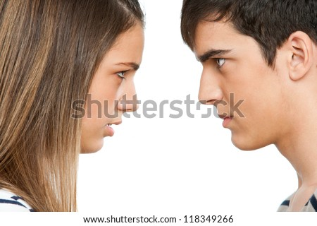 Close up portrait of teen couple with angry face expression.Isolated. - stock photo