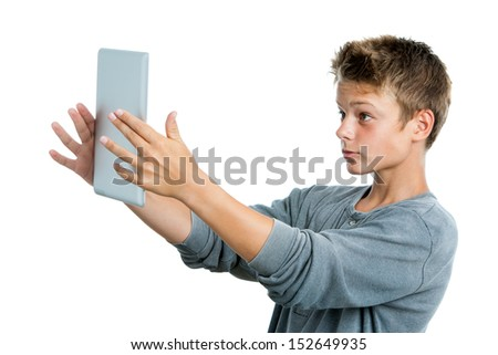 Close up portrait of teen playing game on digital tablet.Isolated on white background.