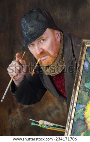 close-up portrait of the adult artist with red beard and mustache in studio on dark background - stock photo