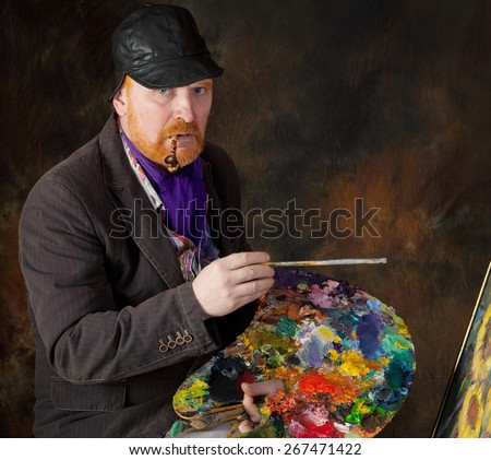 close-up portrait of the adult artist with red beard and mustache on dark background - stock photo