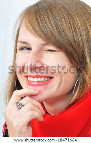 close-up portrait of the winking girl - stock photo