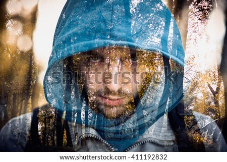 Close-up portrait of threatening gangster wearing a hood, representing the concept of danger. Close-up portrait of threatening gangster wearing a hood, representing the concept of danger - stock photo