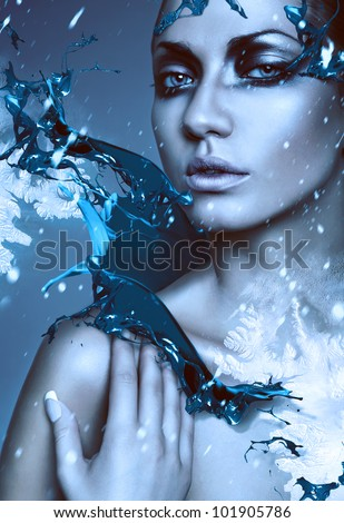 close up portrait of winter woman with blue splash