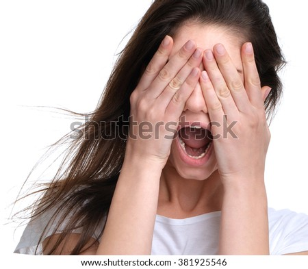 Close up portrait of woman angry yelling frustrated screaming out loud and close eyes with hands isolated on a white background