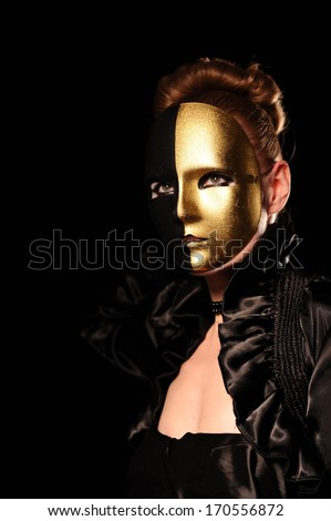 Close-up portrait of woman in mask. can be use for vampire concept - stock photo