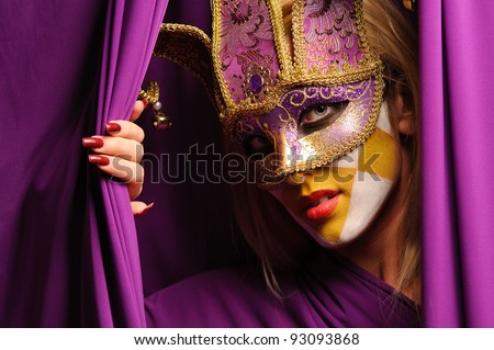 close up portrait of woman in violet carnival mask - stock photo