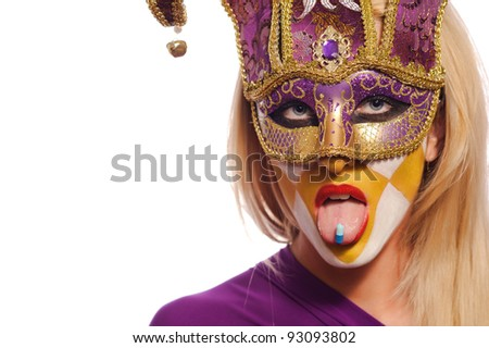 close up portrait of woman in violet mask with blue pill on tongue, isolated on white - stock photo